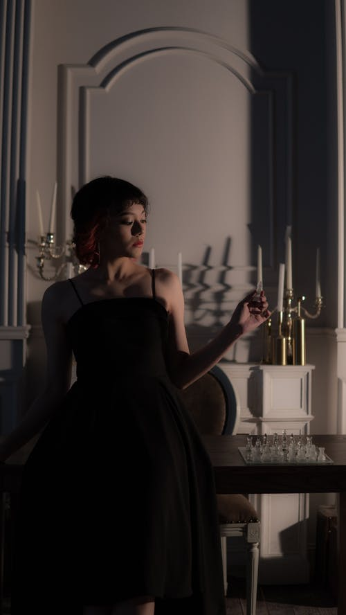A Woman Posing in a Black Dress