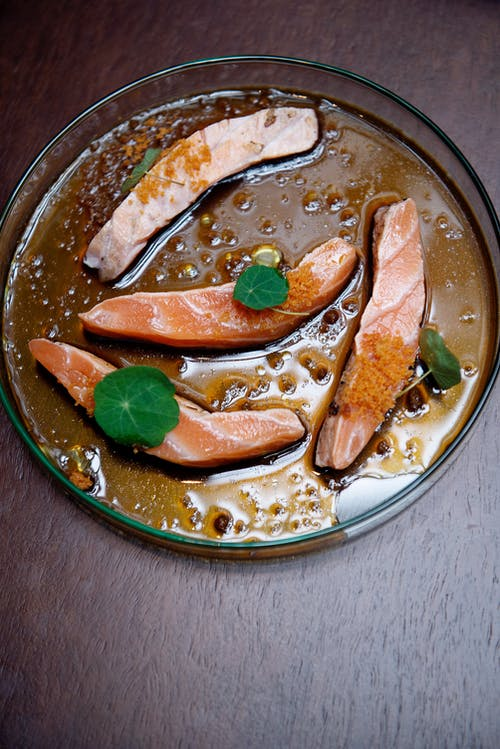 Brown and White Food on Round Stainless Steel Plate