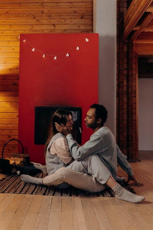 Couple Sitting Near Fireplace