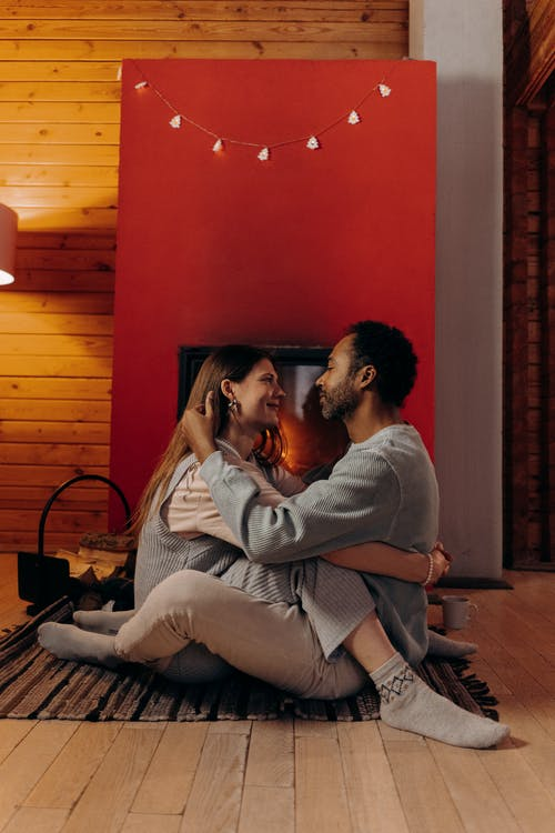 Couple Sitting Near Fireplace