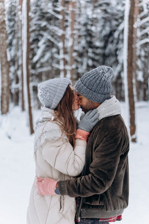 Free stock photo of affection, beanie, blur