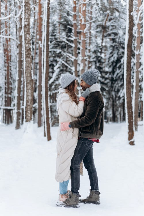 Romantic Couple Standing Face To Face In The Woods