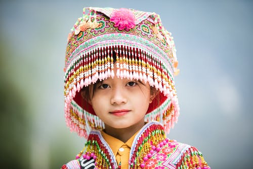 Asian girl in Miao hat