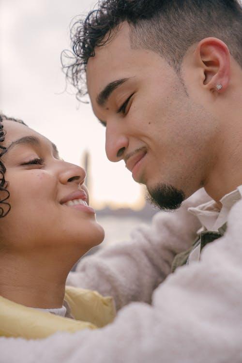 Hispanic happy couple smiling and cuddling