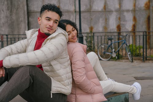 Romantic Hispanic couple recreating in park during date