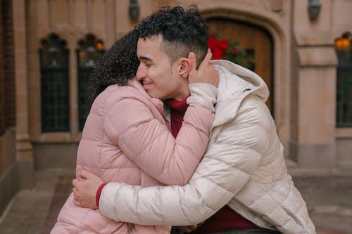 Romantic Hispanic couple hugging each other