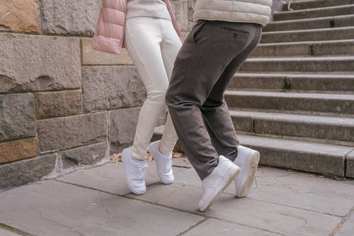 Young couple touching knees while dancing together