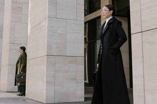 Women Standing Near the Wall