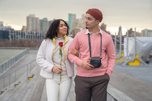 Man in Pink Knit Cap and Woman in White Cardigan