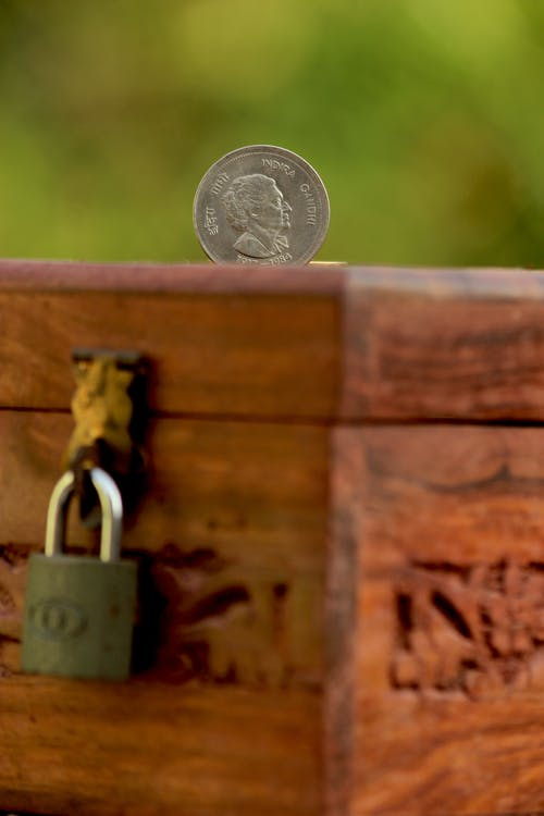 Silver Padlock on Brown Wooden Fence