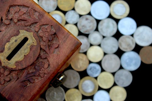 Brown Wooden Box With Silver Round Coins