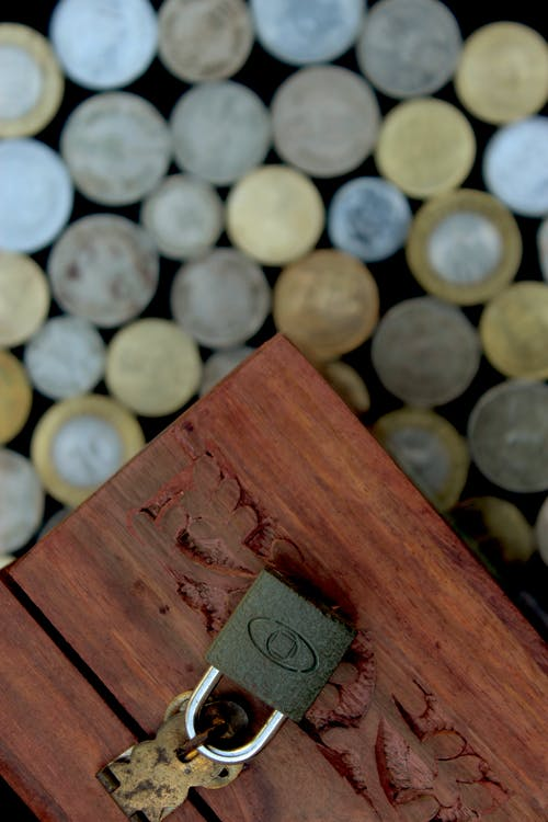 Brown Wooden Box With White Round Coins