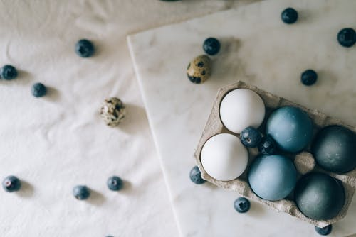 Blue Colored Eggs And White Eggs On Marble Surface