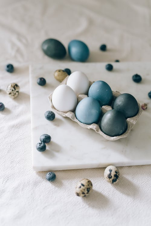 Blue And White Eggs In A Carton