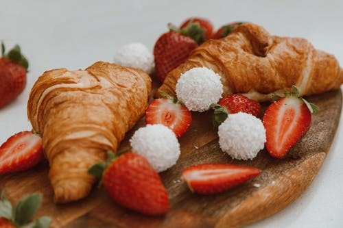 Bread With Strawberry on Brown Wooden Chopping Board