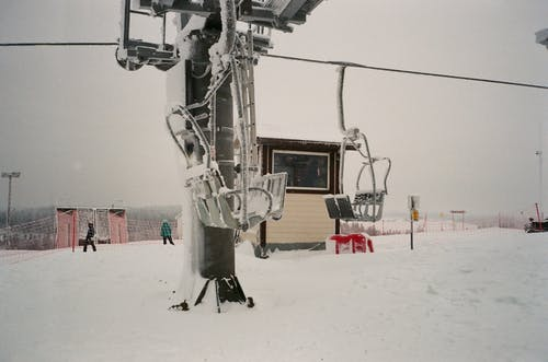 Cable cars riding above snowy spacious ski resort