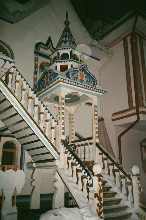 Ornamental medieval stairway of white and blue colors