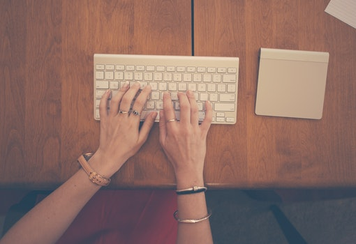 Free stock photo of hands, woman, apple, desk