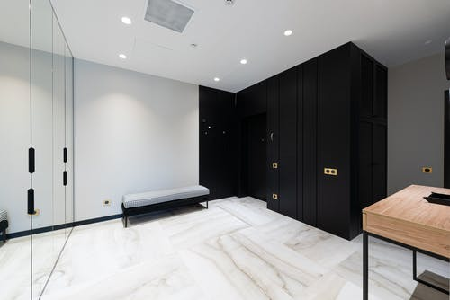 House interior with cabinet near door and bench in hallway
