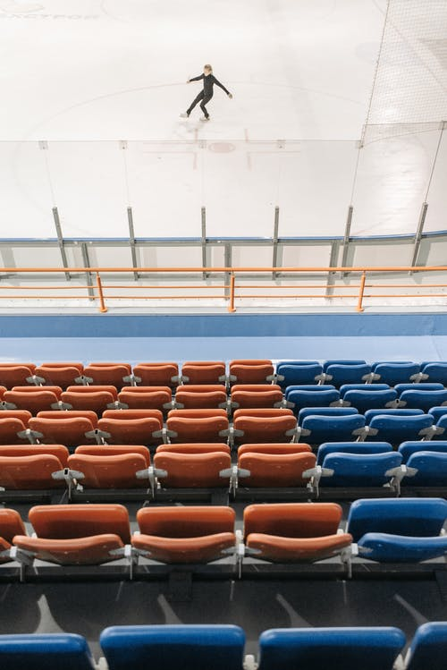 Blue and Orange Chairs in Stadium