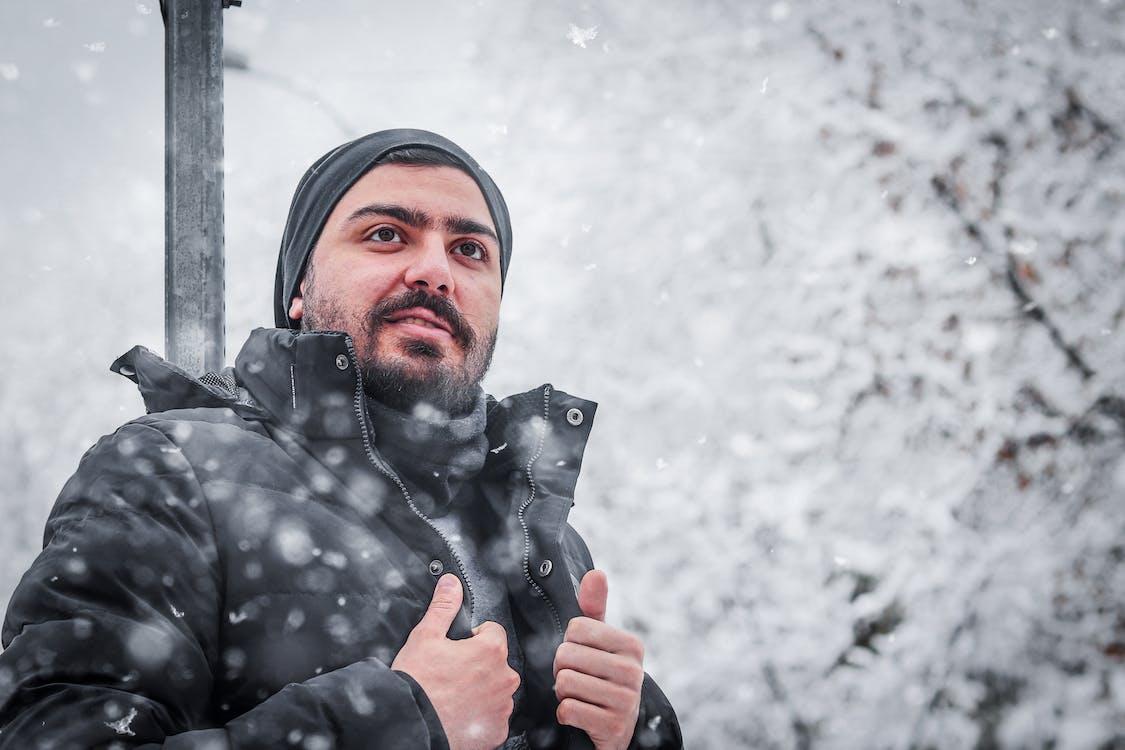 Man in Black Jacket Holding Black Umbrella