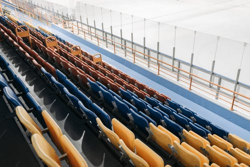 Blue and Brown Chairs on Stadium