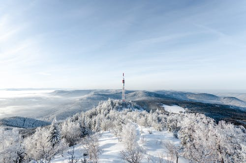 A Satellite Tower on Top of a Mountain