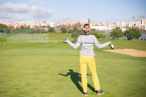 Back View of Woman Holding Golf Club