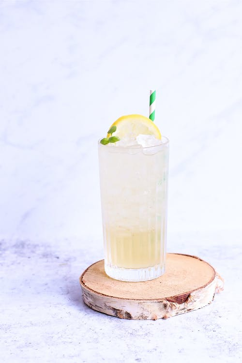 Delicious lemonade with lemon slice and straw