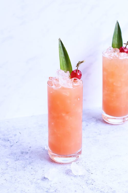 Glasses of fresh icy cocktails on marble table