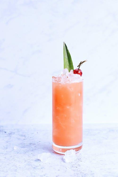 Glass of refreshing berry lemonade on marble table