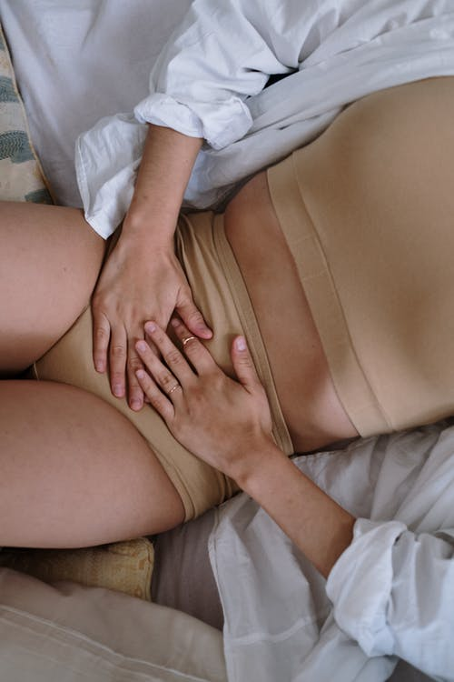 Woman Suffering from a Stomach Pain