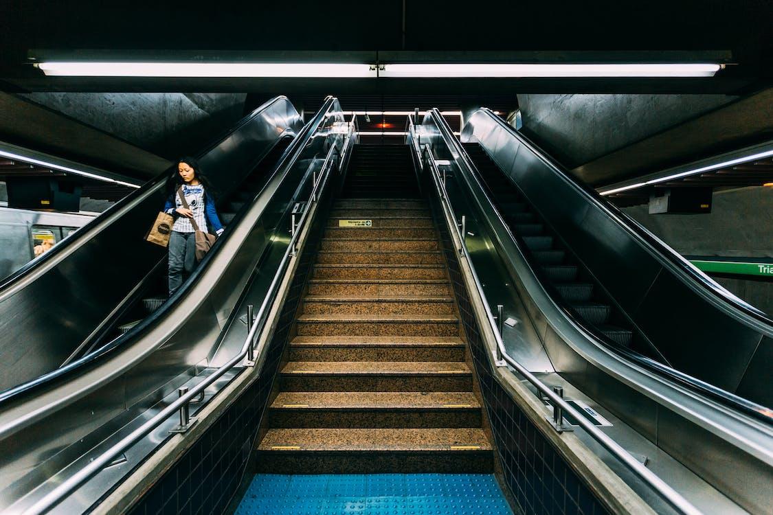 Woman on Escalator in Subway