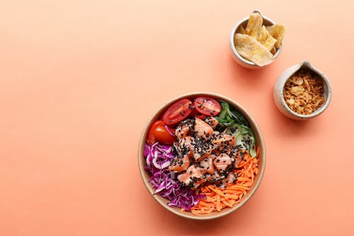 Bowls with poke and dried fruits