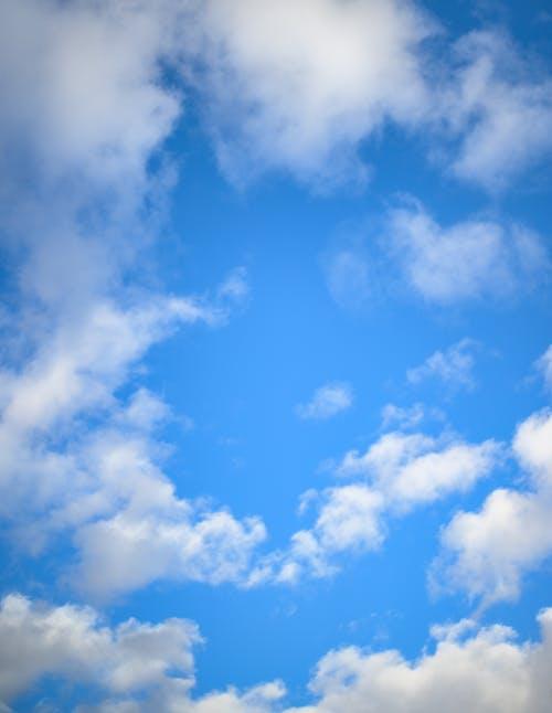 Fluffy clouds floating in blue sky