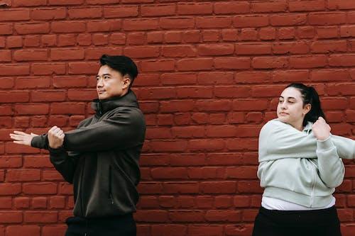 Foto profissional grátis de ação, activewear, alongar