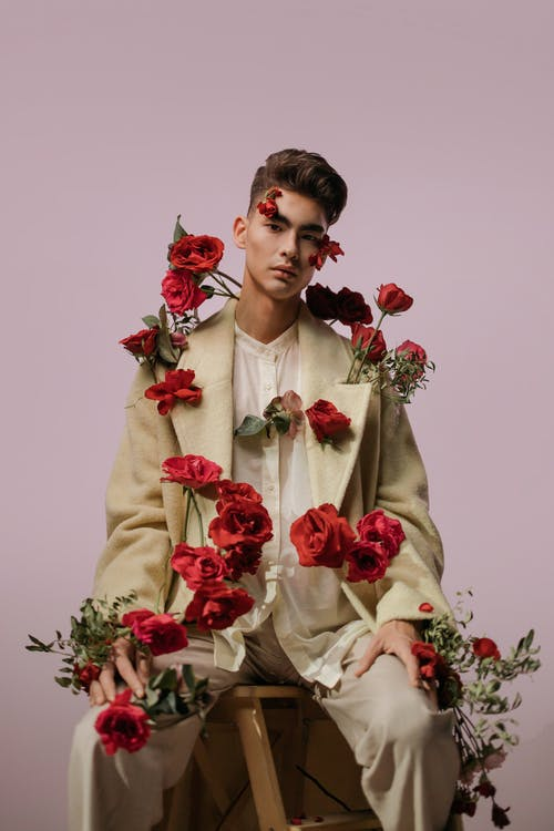 Man In Beige Suit With Red Roses