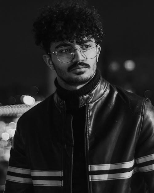 Man in Black Leather Jacket With Eyeglasses