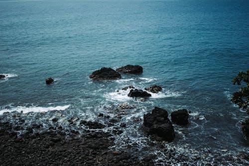 Black Rock Formation on Sea