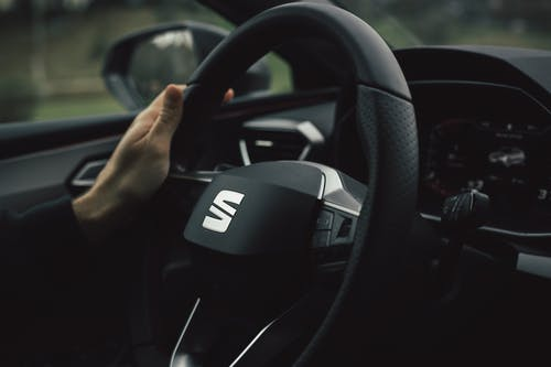 Person Driving Black Honda Car