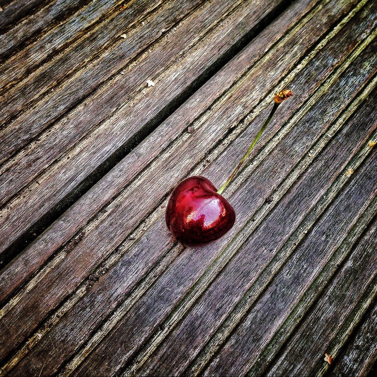 Red Cherry on Wooden Surface
