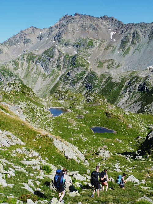 People Hiking on Mountains