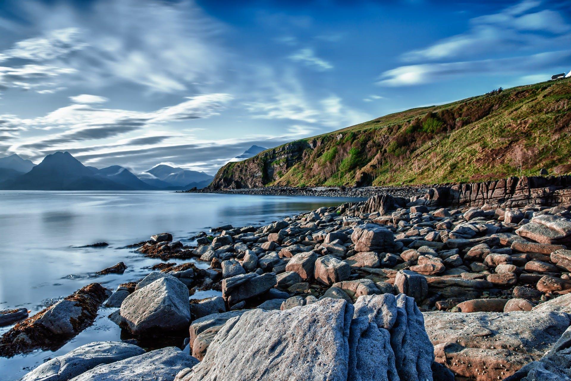 Big Rocks Near Ocean Under Blue Sky