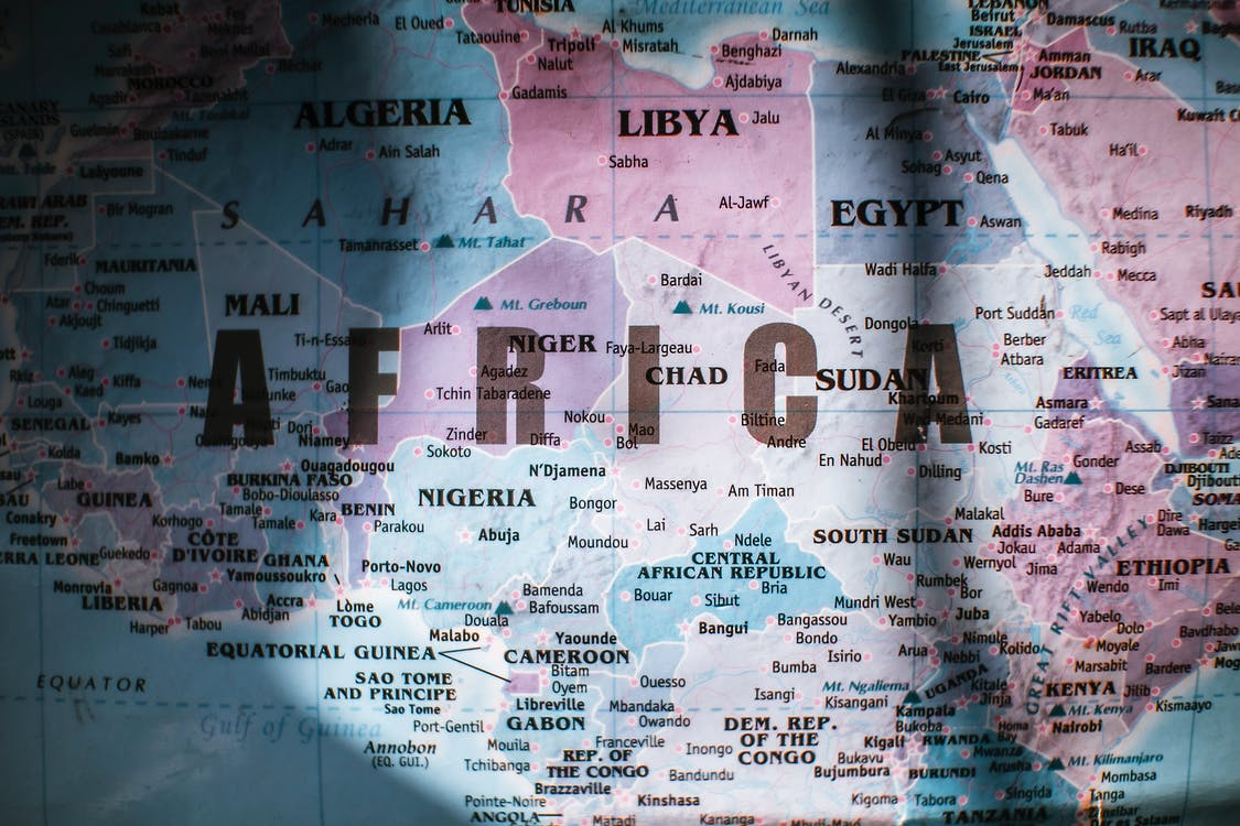 Closeup of map of Africa with countries borders and water on sunny day
