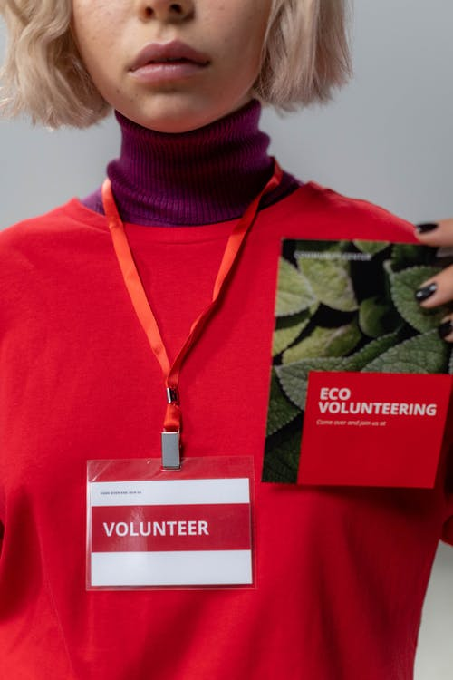 Close-up Photo of Personholding Red Brochure