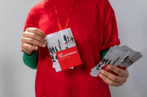 Close-up Photo of Red Brochure