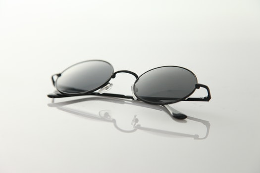 Black Frame Sunglasses on White Surface