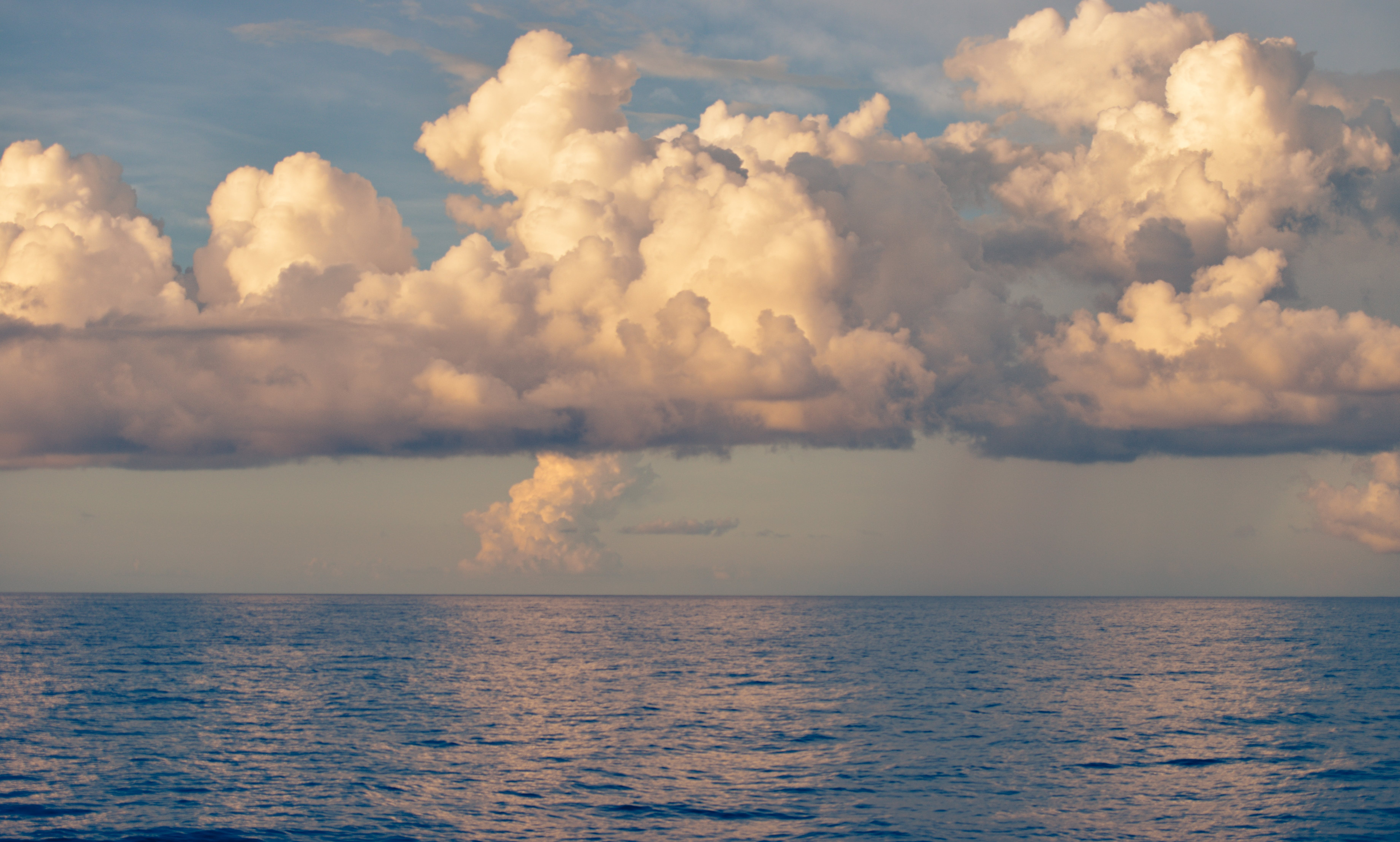 Blue Body of Water Under White Cloud