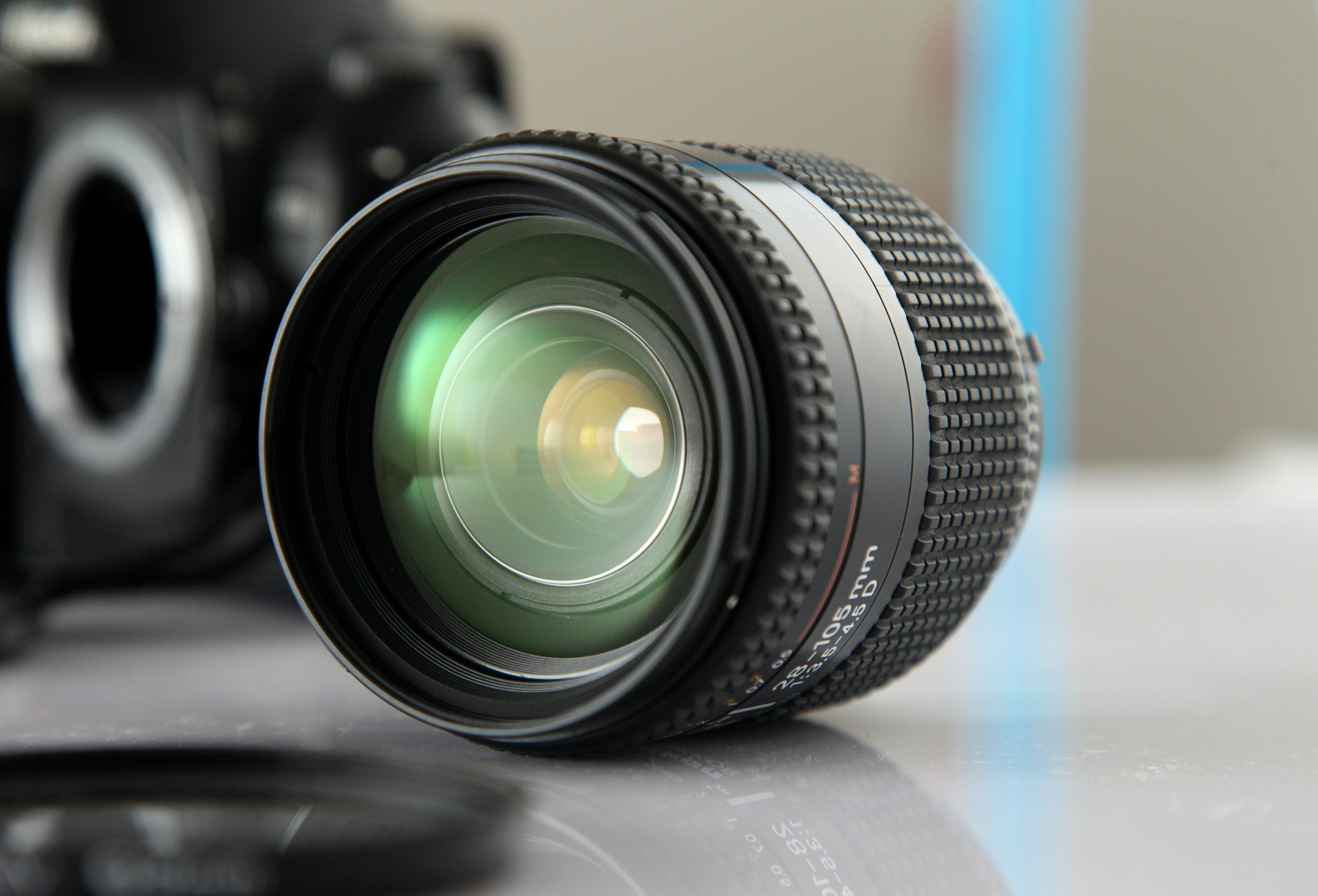 Black Camera Lens on White Sureface