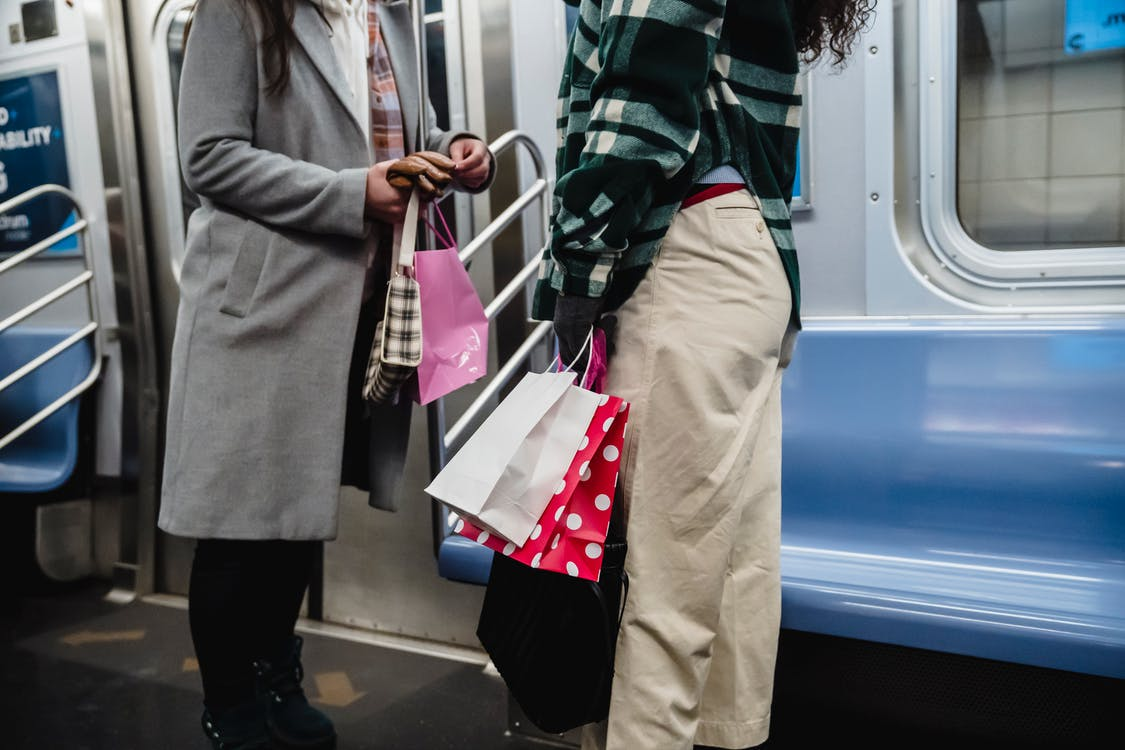 Crop women riding in subway train